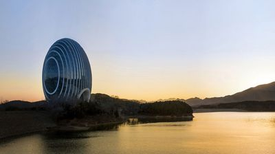It's designed to look like a rising sun, has an entrance shaped like the mouth of a fish and from the side it resembles a scallop. It is the Sunrise Kempinski Hotel that opens next month in Beijing, the latest luxury hotel that has taken two years to build, says the team behind it who have revealed the meanings behind its unique design.<br> <b>(All images: Sunrise Kempinski Hotel)</b>