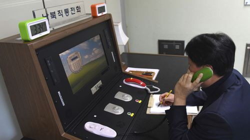 A South Korean official speaks to a North Korean officer on the newly reopened hotline. Photo: AAP