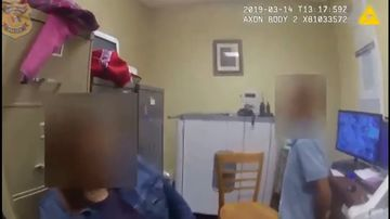 In the video the boy is heard telling his mother he is scared after police place him in handcuffs.