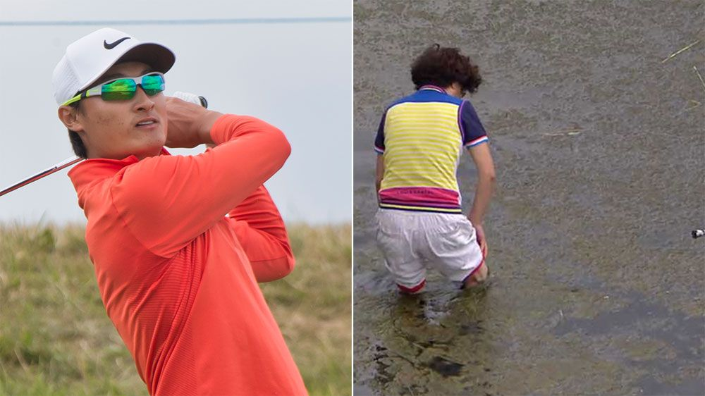 Golfer's mum wades in water to save putter