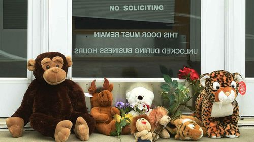 Stuffed animals adorn the doorstep of Dr. Walter Palmer's River Bluff Dental office in Bloomington.