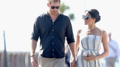Royals cradling baby bump