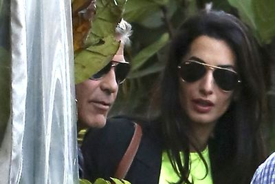 George and Amal rocked up to their party in matching sunnies. It will be coordinated outfits next!