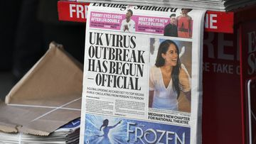 The front page of the Evening Standard is displayed at Bond Street Station, in London