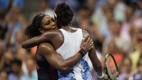 Serena and Venus Williams embrace after their women's singles quarter final match at the US Open. (AAP)