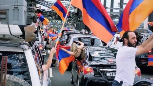 Protesters waved Armenian flags on the bridge.