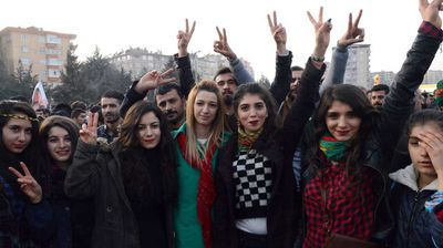 Kurdish women flash the victory sign during a rally in Diyarbakir, southeastern Turkey.