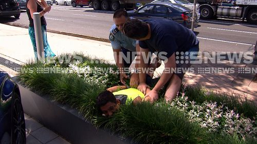 An off-duty firefighter came to help in the arrest of an allegedly drunk truckie.