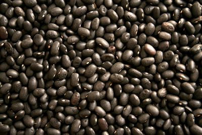 Half a cup of cooked black beans (86g): 7.5g fibre