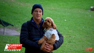 Mark Gilesspie with Cavoodle Oscar, who he gave to friends to care for while working away.