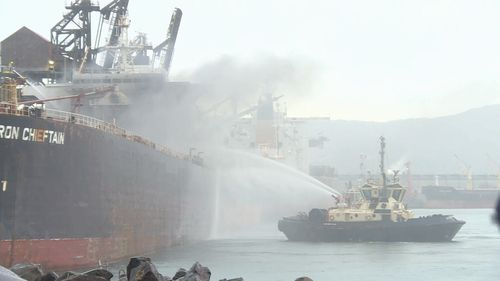 An iron ore carrier has caught alight in Port Kembla Harbour. Picture: Nine