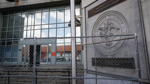 Fencing stands outside the main entrance of the Metropolitan Detention Center, Brooklyn where British socialite Ghislaine Maxwell is held, Tuesday, July 14, 2020, in New York.