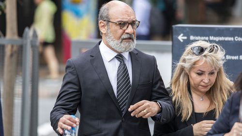 Dr Ramin Harirchian arrives at the Brisbane District Court in Brisbane, Monday, November 25, 2019