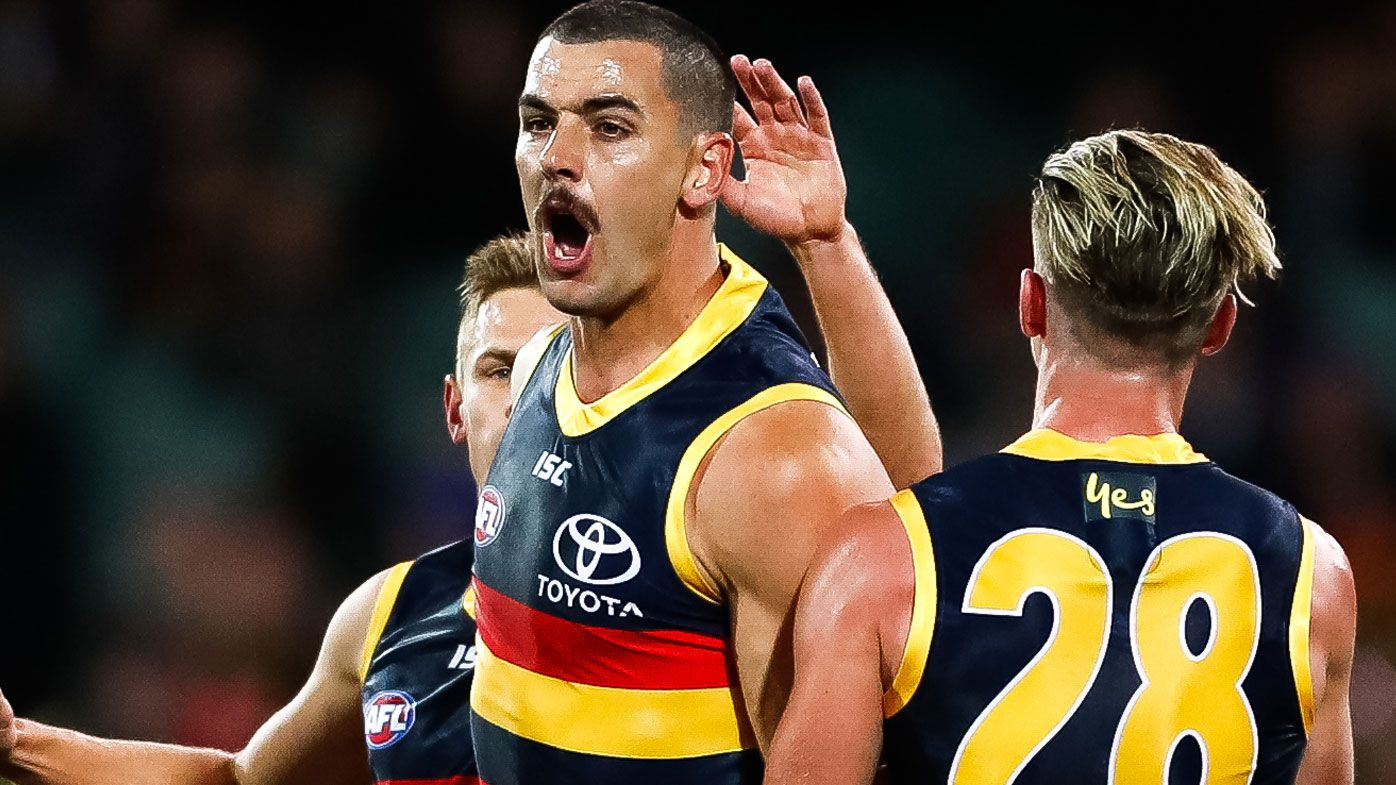 Taylor Walker of the Crows celebrates after kicking a goal