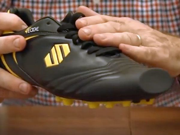 A revolutionary new boot with a square toe has been designed for football. (Supplied)