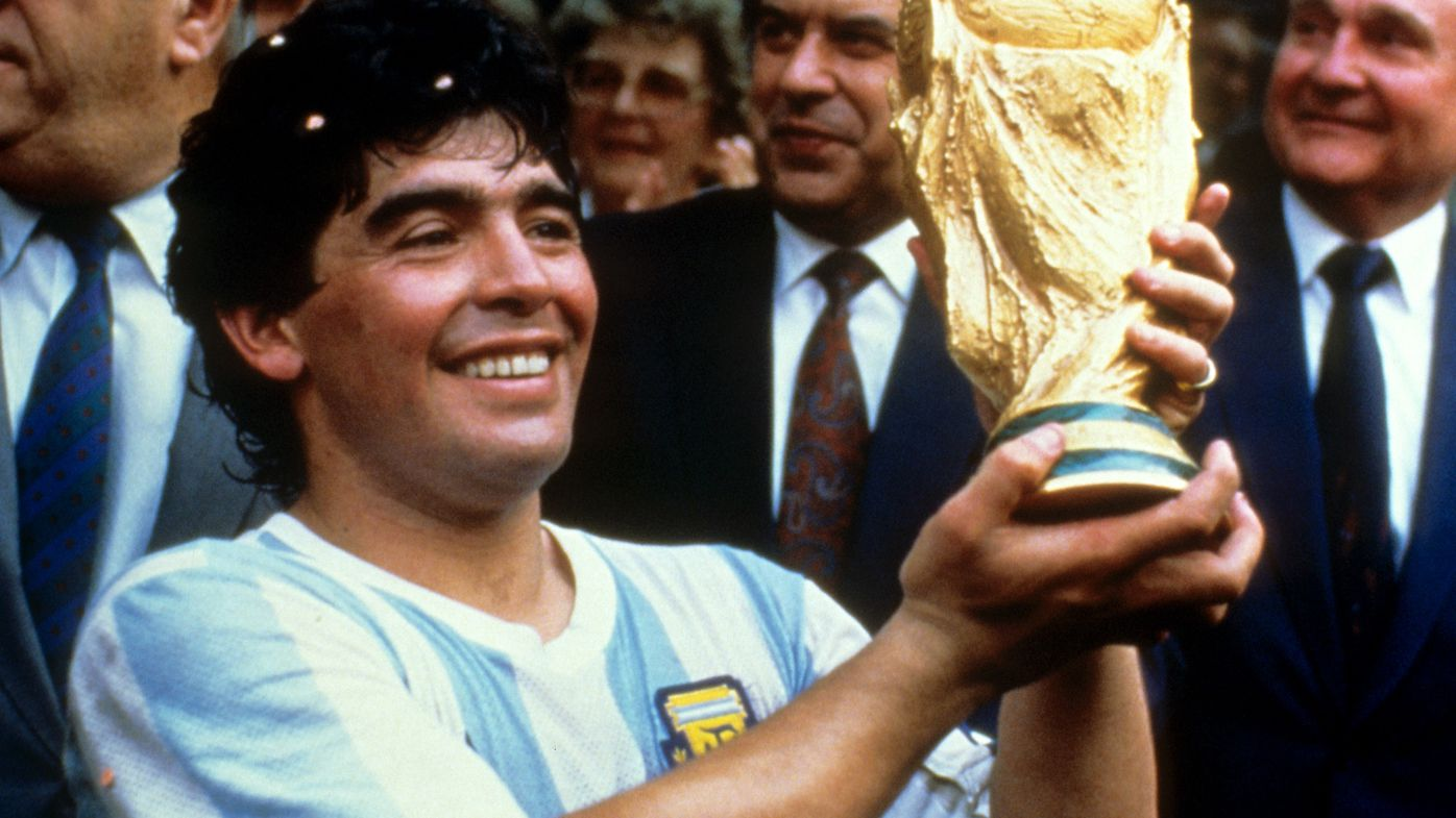 Diego Maradona holds up the World Cup trophy in 1986