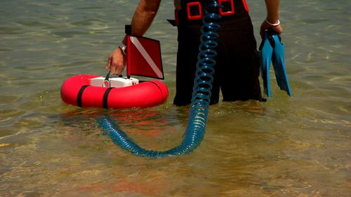 The Airbuddy, invented by Sydneysider Jan Kaldac, is a battery powered portable compressor that floats on water and follows you as you swim. (9NEWS)