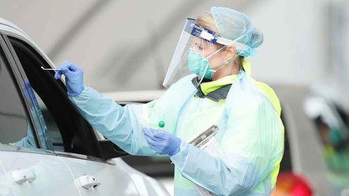 Medical professionals conduct a nasal swab test at the COVID-19 Bondi Beach drive-through testing centre.