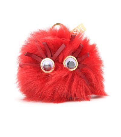 "<a href=""http://www.mytheresa.com/en-au/large-pom-pom-sheep-fur-keyring.html?"" target=""_blank"">Keyring, $280, Sophie Hulme at mytheresa.com</a>"