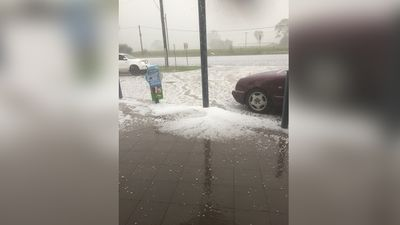 Hail buries a street outside an IGA in Luddenham, in Sydney's west. (Frank F)