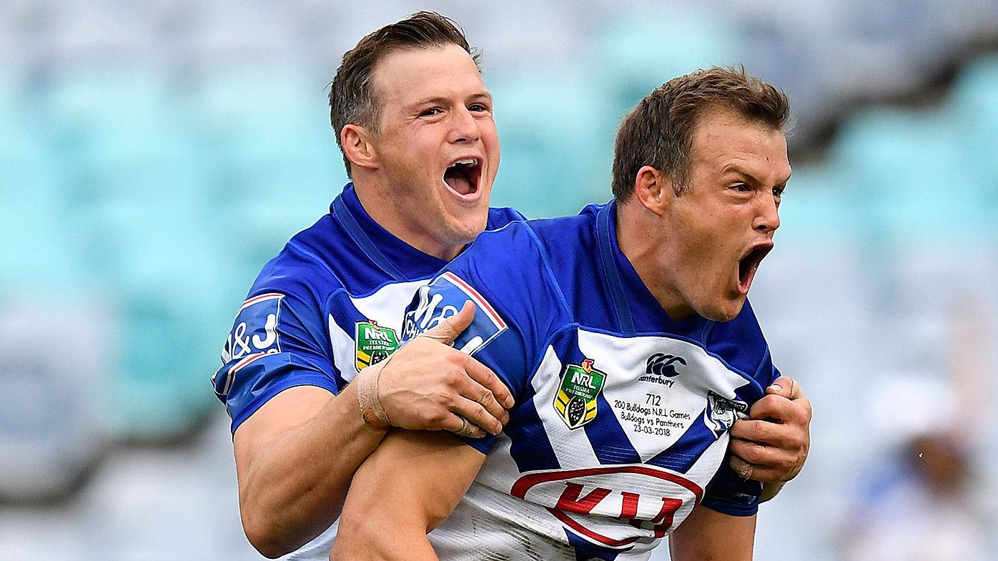 Josh Morris of the Bulldogs (right) celebrates with brother Brett (left) after scoring a try