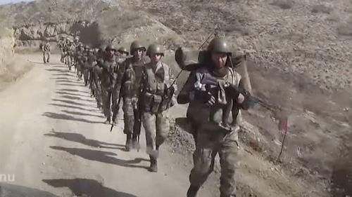 Azerbaijan's solders walk in a formation on a road during a military conflict in the separatist region of Nagorno-Karabakh (Photo: October 9, 2020)