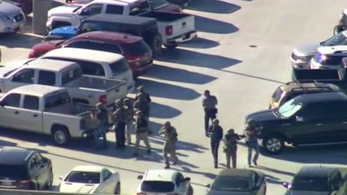 Aerial shots show police in the car park. (Supplied)