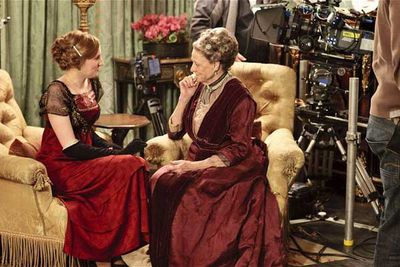 Laura Carmichael (Lady Edith Crawley) and Dame Maggie Smith (Violet) filming a scene.