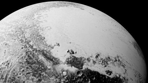 New Pluto photos reveal soaring mountains, dunes and frozen ice floes