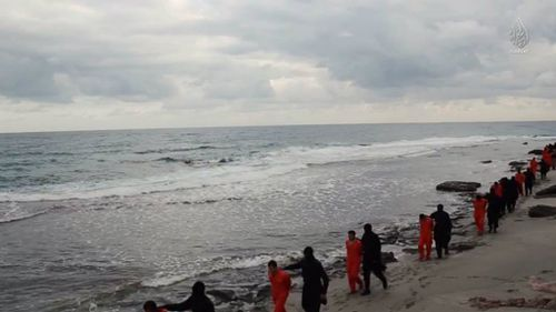 The Christians are seen being led down a Tripoli beach before being brutally murdered. (Supplied)