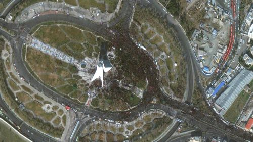 Satellite photo from Maxar Technologies shows Azadi Tower in Tehran, Iran, amid a mass processional for Iranian Gen. Qassem Soleimani, who was killed in a US airstrike in Baghdad.