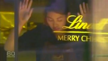 Staff members were forced against the glass of the Lindt Cafe. (9NEWS)