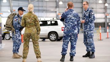 ADF personnel assist with a COVID-19 testing at Melbourne Showgrounds