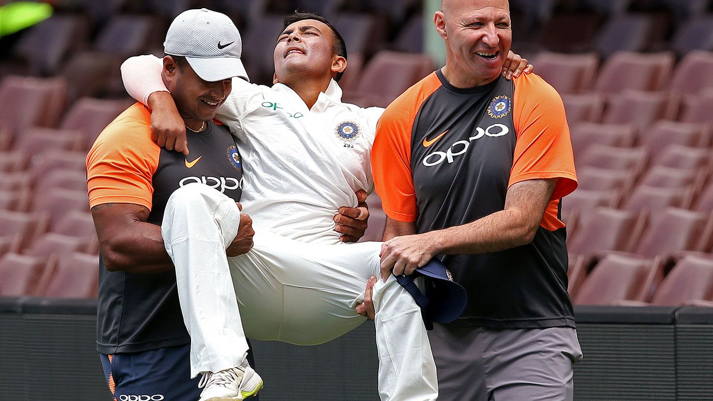 Prithvi Shaw is carried from the field at the SCG.