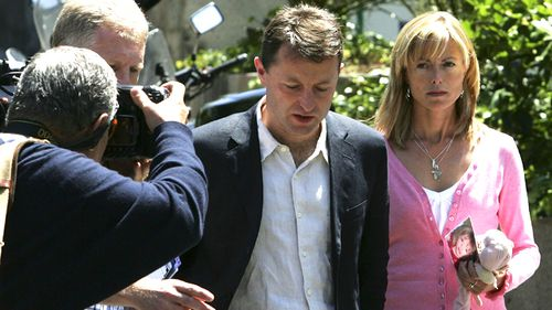 Kate and Gerry McCann in Madrid, Spain, four weeks after their daughter Madeleine Beth McCann vanished. Kate is holding Maddie's toy, Cuddle Cat. (Getty)