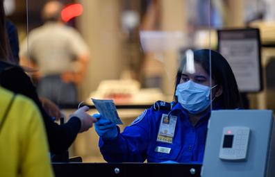 TSA security staff wearing a mask