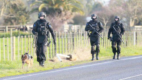 Police surround the scene in Gordonton.