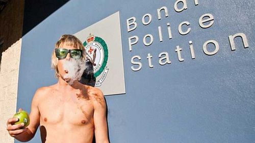 He also posed in front of six Sydney police stations last year as part of his own controversial decriminalisation protest. (Supplied)