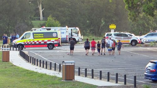 Emergency workers and witnesses at the scene.