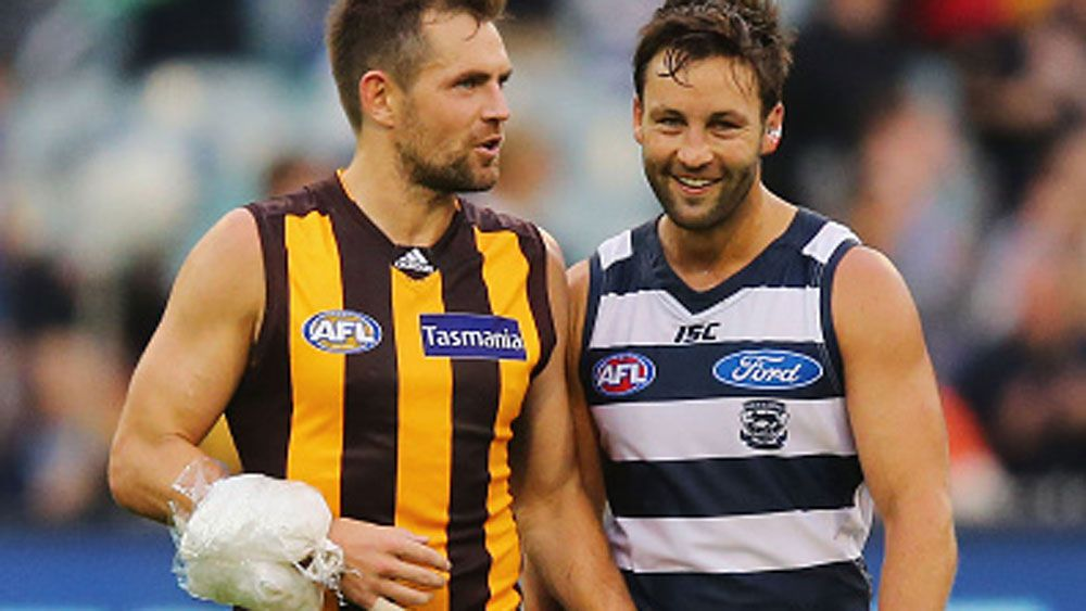 An iced-up Luke Hodge speaks with Jimmy Bartel after the loss. (Getty)