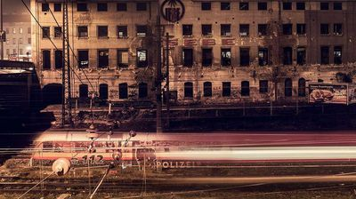 """112: """"I was taking a panorama shot of the abandoned 'Gebe' factory in the 14th District, Vienna. In the foreground a strange police-train is stopping. i have never seen one before."""" Christian Stangl, 2nd place, Austria, National Award, 2015 Sony World Photography Awards."""