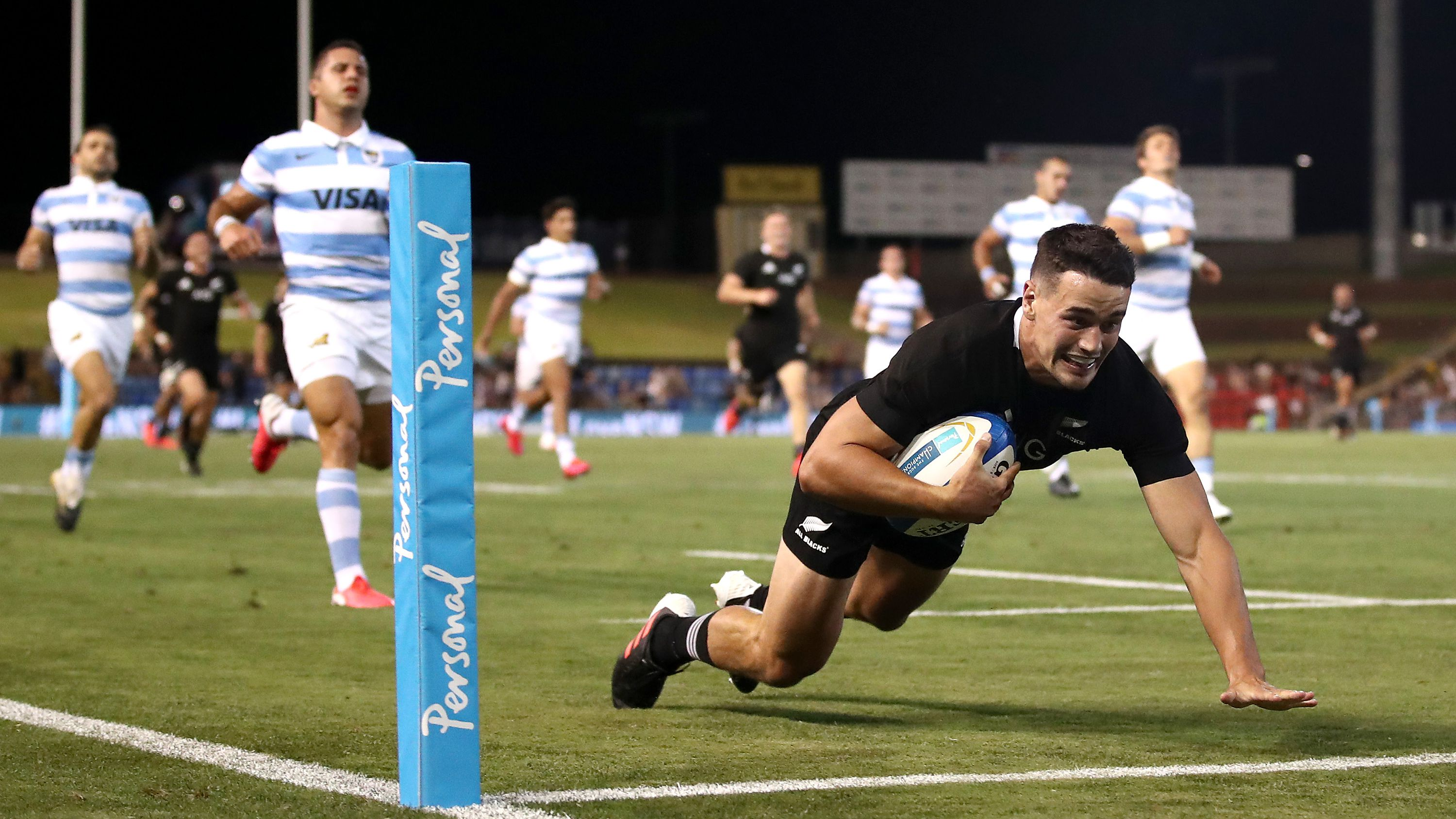 Will Jordan of the All Blacks makes a break to score a try.