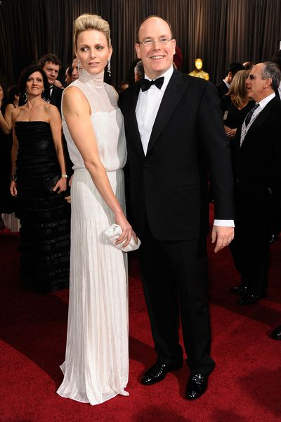 Princess Charlene wearing  Akris, and Prince Albert II of Monaco  at the 84th Annual Academy Awards in Hollywood in February, 2012