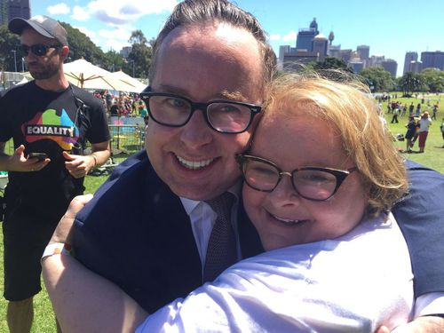 Prominent Yes campaigners Alan Joyce and Magda Szubanski embrace after the result was handed down (9NEWS/Mark Burrows)