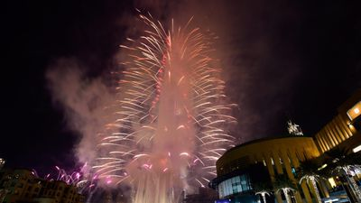 Fireworks lit up the Burj Khalifa, the tallest building in the world, in Dubai. (AAP)
