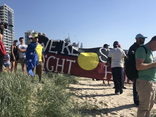 A group of about 50 Aboriginal protesters took to the Sunrise broadcast on the Gold Coast. (9NEWS)