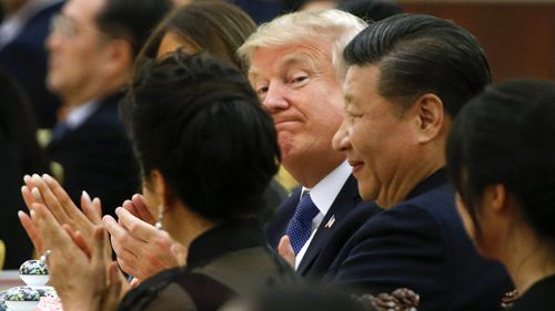 US President Donald Trump and China's President Xi Jinping attend at a state dinner at the Great Hall of the People in Beijing, China. (Getty)