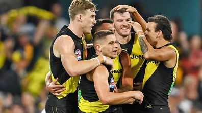 Dion Prestia of the Tigers celebrates kicking a goal with team mates during the 2020 AFL Grand Final