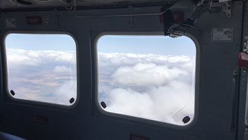 RACQ Rescue helicopter has been stood down and is returning to base in Mackay. Firefighters believed to have walked trapped people to safety at Blackdown Tablelands.