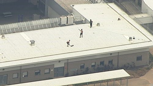 Youths on the roof of the Cobham Youth Justice Centre.